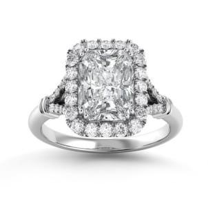 Кольцо с центральным бриллиантом изумрудной огранки