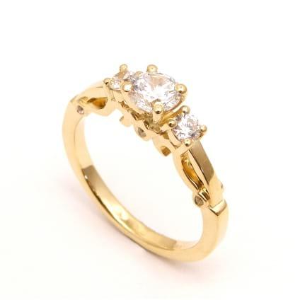 Оправа - кольцо в розовом золоте с тремя бриллиантами
